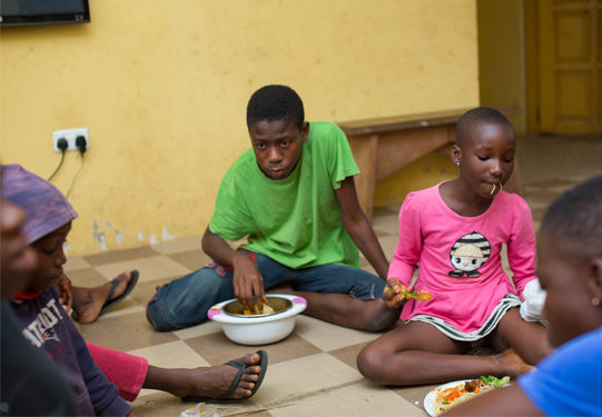 Children at the Orphanage enjoying their meal at the party.